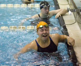 OPRF junior Samantha M. Neilson reacts to her finish time in heat 3 of the 100-yard butterfly at the IHSA Girls Sectionals on Saturday, Nov. 14, 2015.
