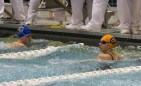 OPRF's Natalie Ungaretti immediately checks for her finish time after completing the 50-yard freestyle at the 2015 IHSA State Swimming & Diving Championship on Saturday, Nov. 21, 2015.