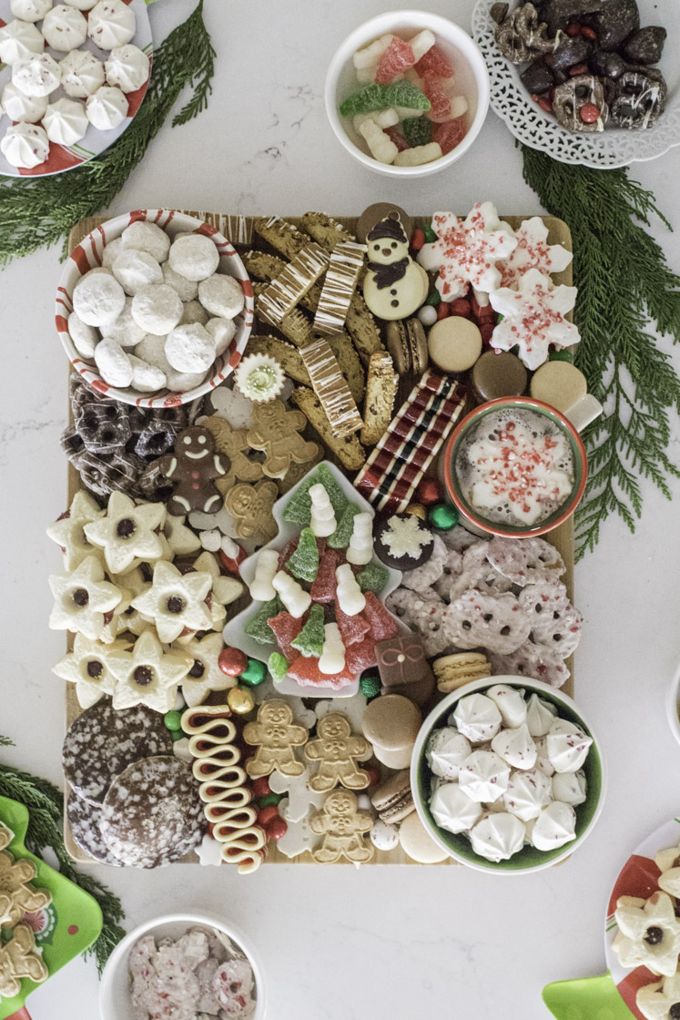 This festive Holiday Charcuterie board is the perfect holiday dessert platter for your upcoming holiday events or to add to your family traditions! Top Arkansas Lifestyle blogger Jennifer Maune shares a shopping list and everything you need to create yours.