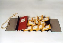 """The Book of Tea, 2005. 3 ¾"""" x 7 ½""""; Artist's book. Binder's board, paper, envelopes, loose tea, ink. Flag binding, with pamphlet. The Book of Tea is a gift. The Book of Tea is to be shared. It both describes and contains a number of herbal teas, which can be brewed separately or mixed together for different moods and occasions."""