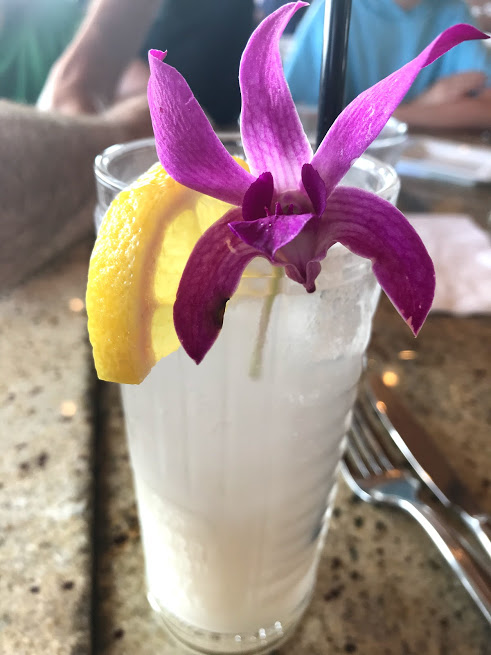 Hawaii cocktail with purple flower