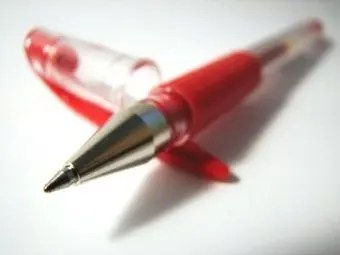 Red ink pen on a white background