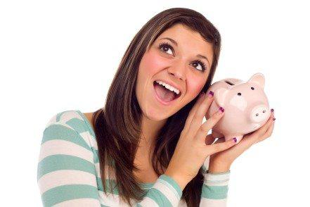 teen shaking piggie bank