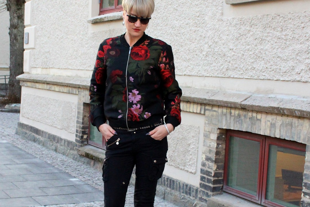 flower bomber jacket cargo pants outfit