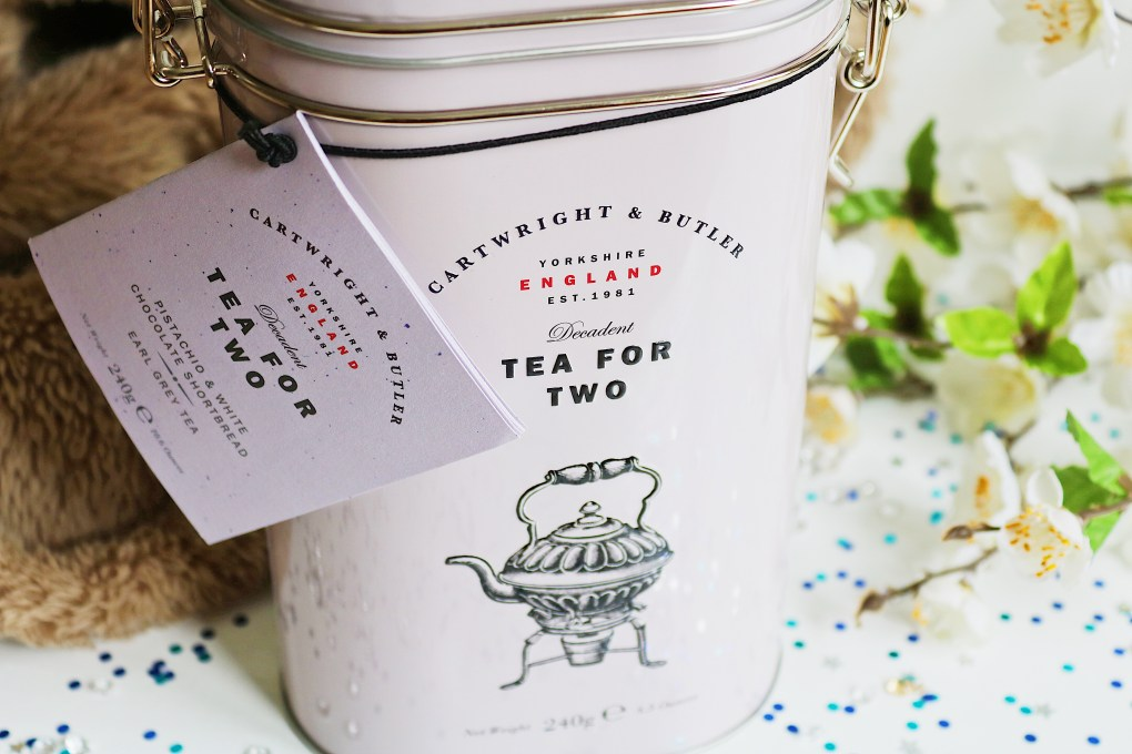 "Father's Day Gift Guide: A pink tin with the writing ""tea for two"" on the front"