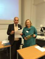 Adnan and me reading in English and Arabic at the end of our event.