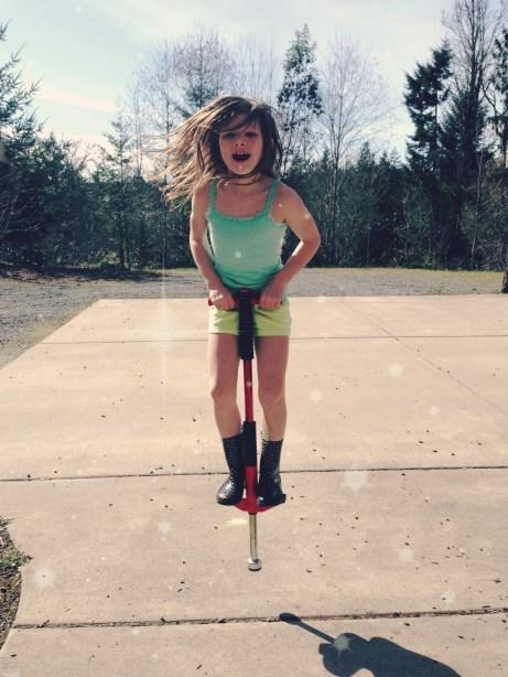 kid on pogo stick via @jennyonthespot