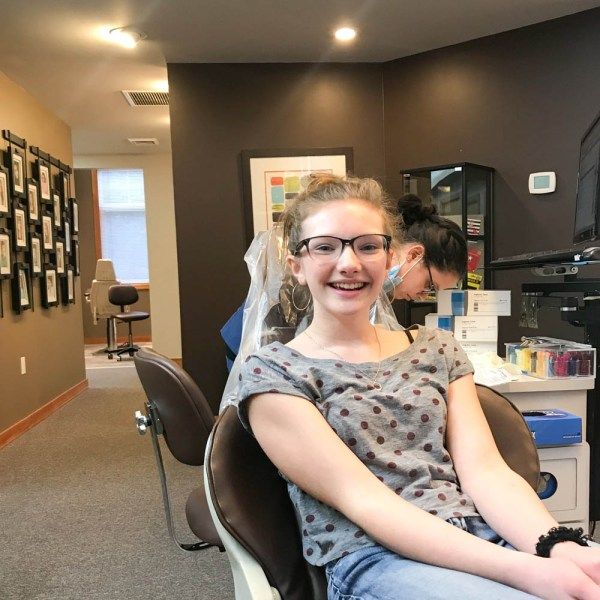 Tween at orthodontist office for Invisalign treatment appointment