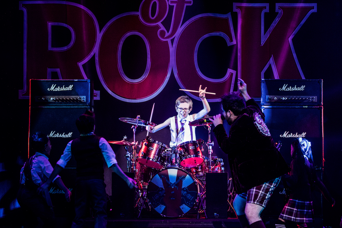 All the kids in School of Rock really play their own instruments! These kids are truly all quadruple-threats... signing, dancing, signing, and instrumental-ing!