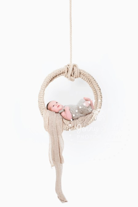 Newborn baby boy in rope swing prop