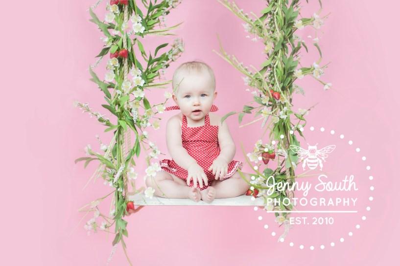 Birthday girl sits on springtime themed swing