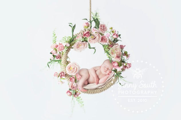 newborn baby in custom made floral swing.