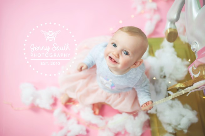 A Baby photo shoot with pinks, fairy lights and clouds