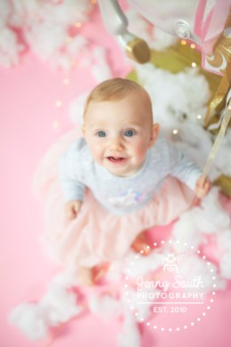 A Baby girl enjoys her unicorn themed photo shoot at our plymouth studio