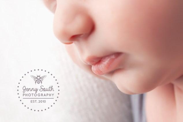 Cherub lips of a newborn baby sleeping soundly