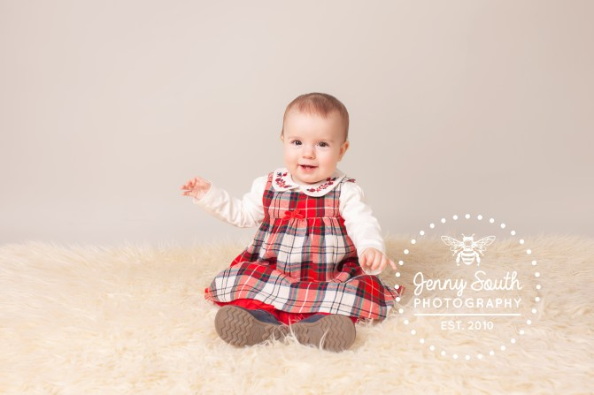 A little girl smile sweetly for her first ever photo shoot.