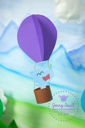 A hand crafted balloon model with a hey Duggee character in against our new exclusive adventure awaits hand painted backdrop.