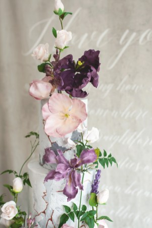 Artisan wedding cake with dusky colours of sugar flowers