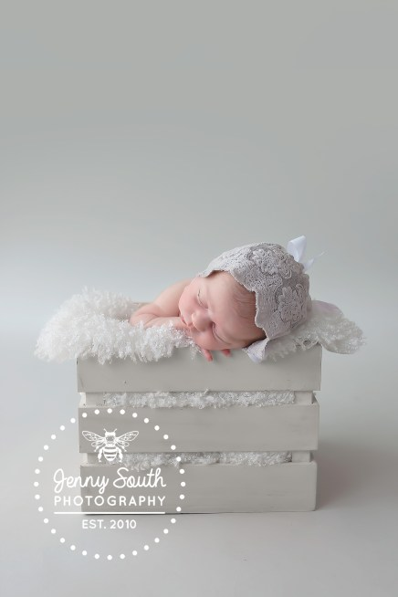 A sophisticated grey newborn session for a beautiful newborn.