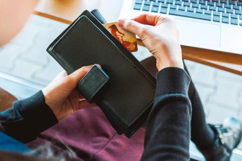 Pulling out wallet to make an online purchase