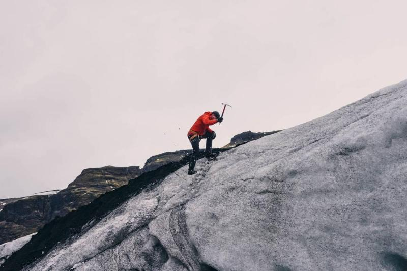 Man with ice pick on glacier