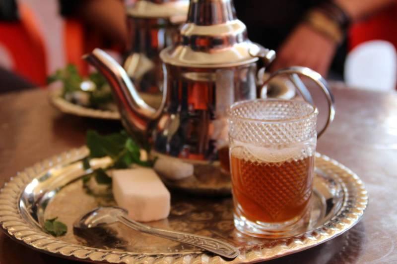 Warm tea on a silver platter