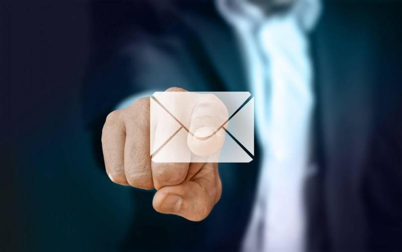 Man pointing at an email icon