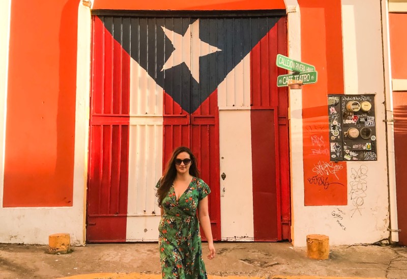 Walking in front of a mural of the Puerto Rican flag