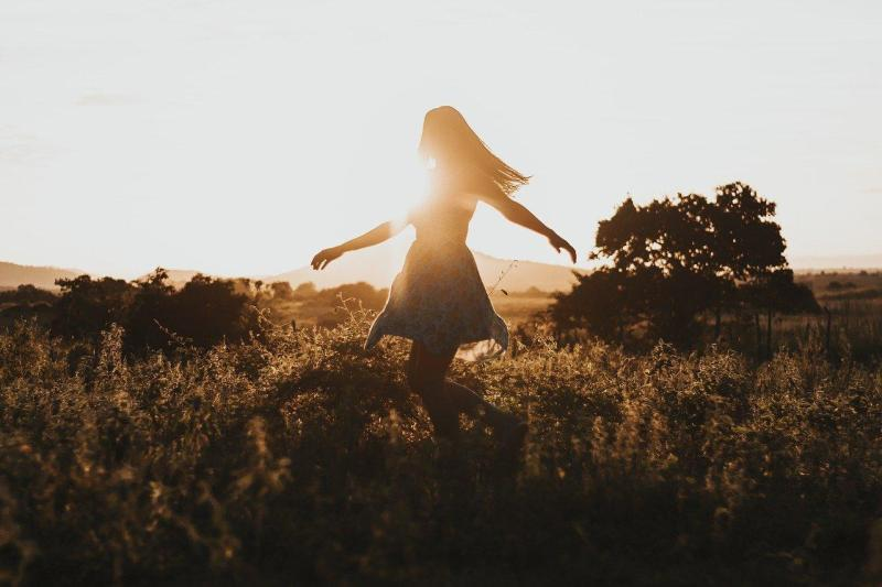 Woman twirling in the sun