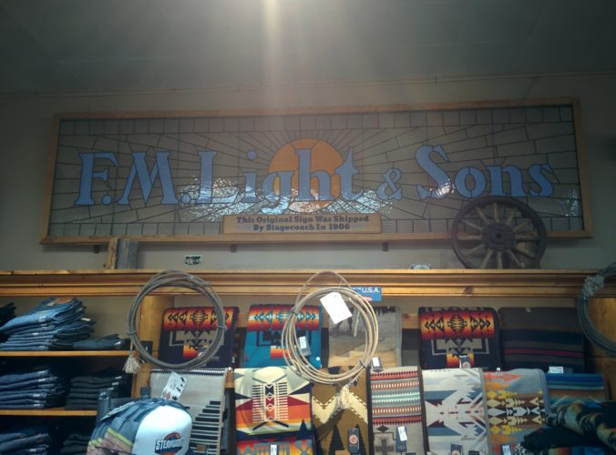 f.m light store sign. a smaller sign underneath reads it was shipped by stagecoach in 1906 fm light store steamboat springs co jenphotographs