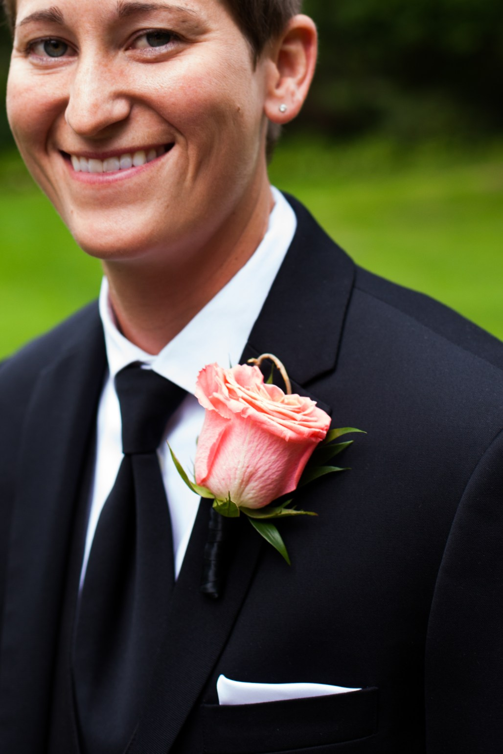 Coral Boutonniere by Jen's Blossoms || photo by Ciccarelli Photography