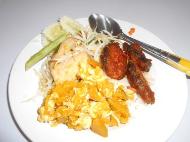Pumpkin with egg, sweet chilli fish, and braised bean curd with been shoots. Plus cucumber and snake bean on the side