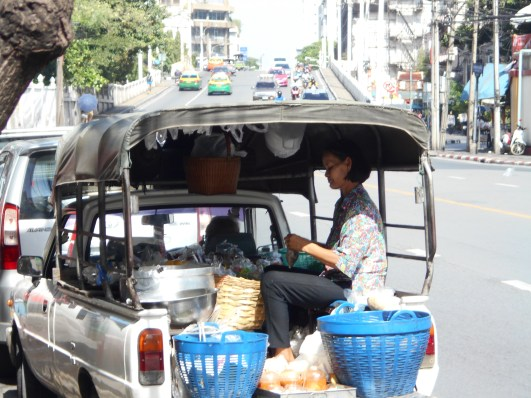 Selling snacks from the back of a ute, recorded announcement blaring from the speakers.
