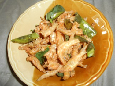 Crispy tiny fish with fried kaffir lime leaves