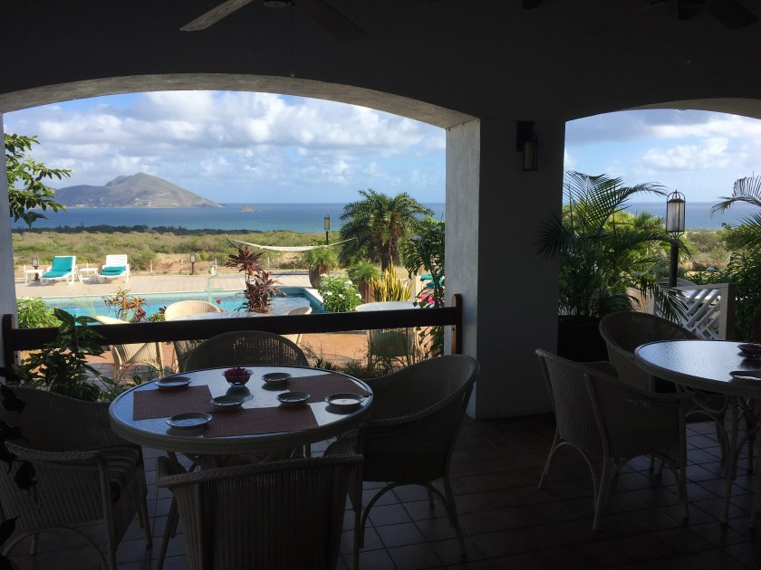 Bella Vista patio restaurant at Mount Nevis hotel for Breakfast with a poolside view