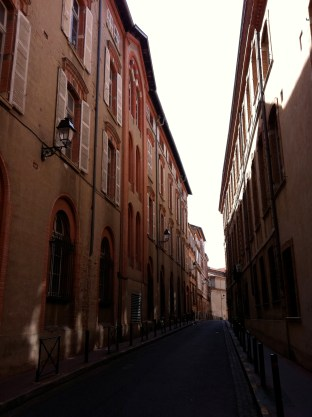 """A typical side street. See why it's called """"la ville rose""""?"""