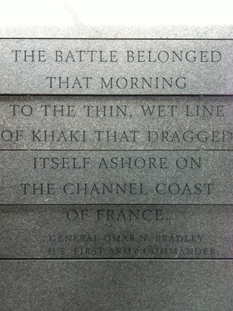 """""""The battle belonged that morning to the thin, wet line of khaki that dragged itself ashore on the Channel coast of France."""" — Gen. Omar N. Bradley"""