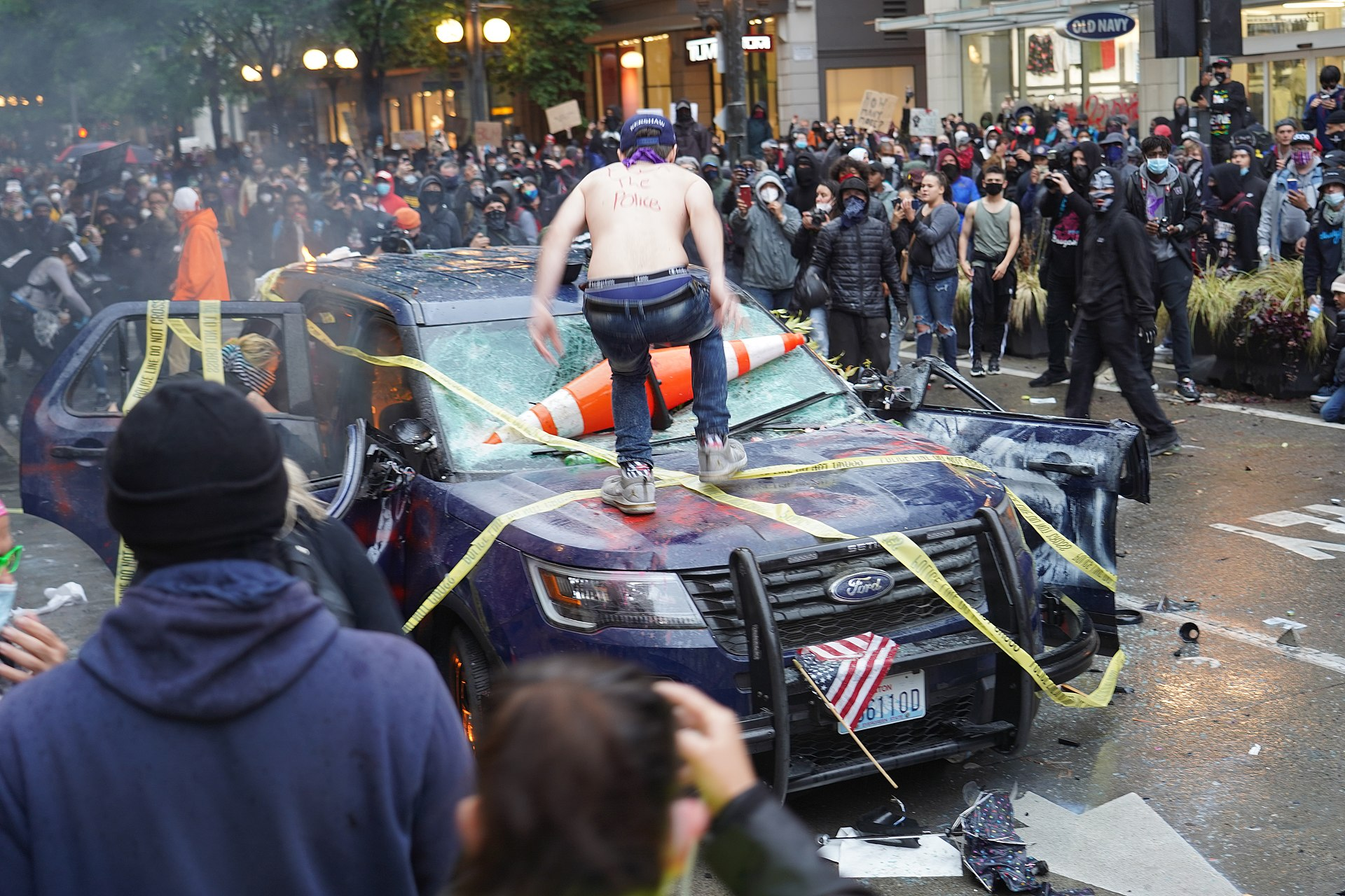 Vandalizing a police vehicle during a riot in Seattle