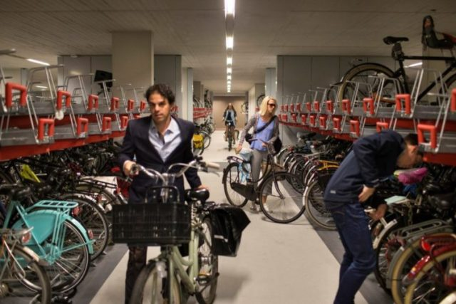 People park in the world's largest underground bicycle parking garage in Utrecht, The Netherlands, Aug. 22, 2017. Utrecht is the Netherlands' fastest growing city and also one of the world's most bike-friendly places in one of the world's most bike-friendly countries. (Ilvy Njiokiktjien/The New York Times)