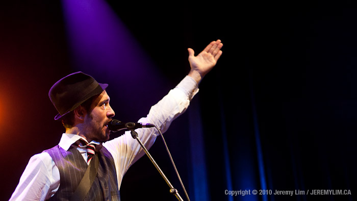 Charlie Winston reaches up at the Vogue Theatre