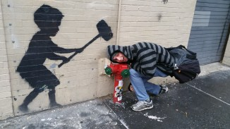 Getting hit by Banksy's painting (...he's trying to knock the tumor out)