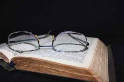 Image of glasses and book.