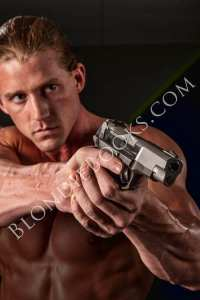 Picture of man aiming pistol.