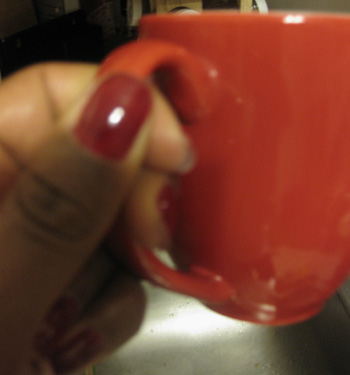 Coffee Mug and Red nail polish