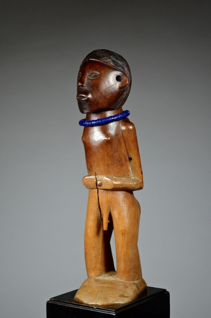 David Malik. Male statuette attributed to the Tabwa Luba-Tabwa, DRC. 19th Century. 33.5 cm Wood, glass paste, pigments. Collected in situ around 1925 by Edouard d'Orjo de Marchovelette £17200. Exhibited at Brussels World Fair in 1958]