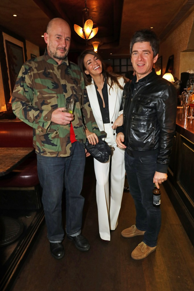 LONDON, ENGLAND - NOVEMBER 16: (L to R) Jake Chapman, Sara Macdonald and Noel Gallagher attend the Kent & Curwen dinner with Mr Porter at Little Social on November 16, 2016 in London, England. Pic Credit: Dave Benett