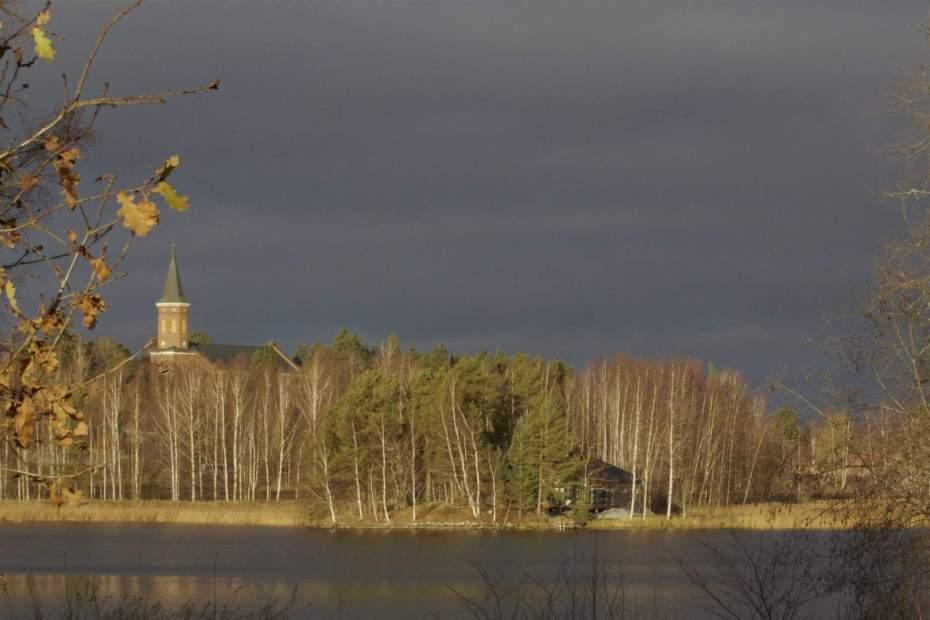 November  lake view with dark clouds