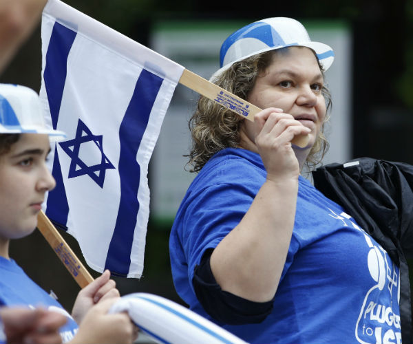 A woman from New York's Rockland County carries an Israeli flag during the annual Celebrate Israel parade Sunday, June 5, 2016, in New York City. (AP Photo/Kathy Willens)