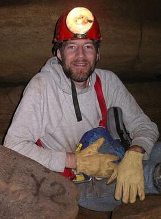 "Picture of Dennis Jerz, wearing a mining helmet, posing next to a rock labeled ""Y2."""