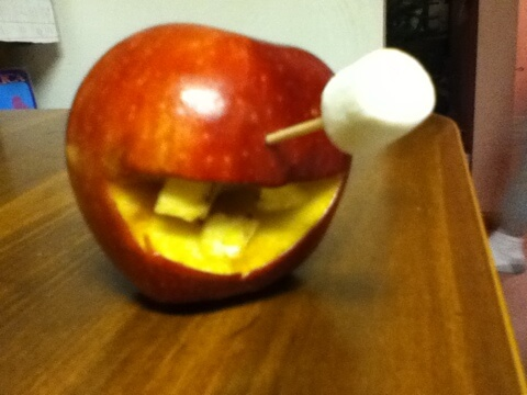 Smiling Cyclops Apple, with Banana Teeth and Marshmallow Eye (by Carolyn Jerz, age 8)